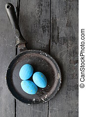 Blue Easter eggs in a frying pan art, holiday decoration -...