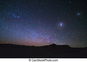 The majestic Magellanic Clouds, outstandingly bright,...