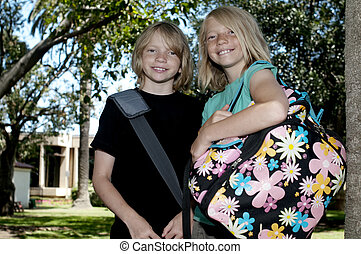Two Kids on First Day of School - Two Elementary Age Kids...