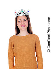Smiling teenager girl with silvered crown on her head