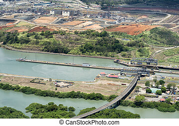 Aerial view of Miraflores locks and the construction of a...