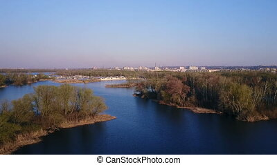 Flight over the Dnieper River in the spring at sunset....