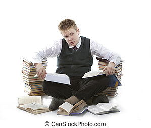 Teenager schoolboy with pile of textbooks