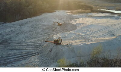 Flight over the excavator at the sand-extracting enterprise....