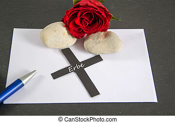 Erbe - german for heritage - envelope with rose and pen
