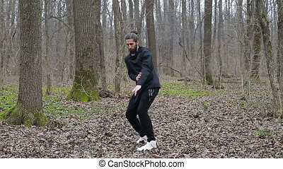 Master wushu and tai chi practiced in the forest in spring