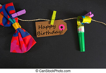 Happy Birthday written on a paper tag