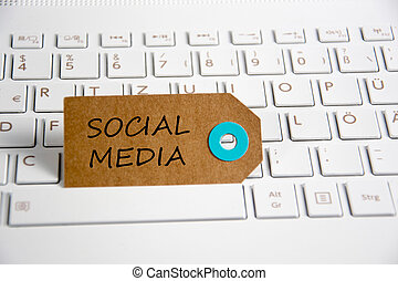 social media written on paper tag on a keyboard
