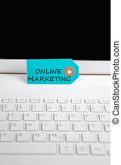 online marketing written on paper tag on a keyboard