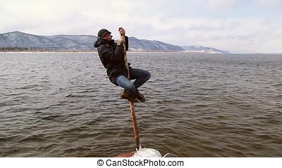 Funny man climbed up the pole