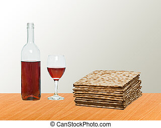 Close up of matza and goblet with red wine