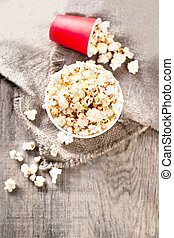 Homemade Kettle Corn Popcorn on wooden background -  cinema, movies and entertainment concept