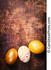 Easter eggs on wooden background with copyspace. Happy...