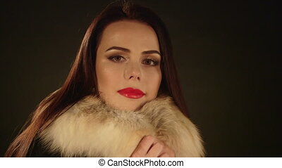 Face of young woman in fur collar