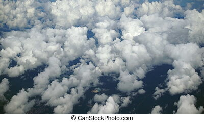 Overlooking View of Cottony Cumulus Clouds, Far Below -...