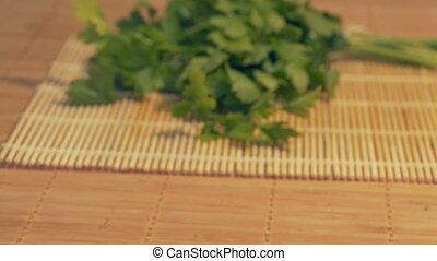 Fresh Lovage on Table - Sliding to fresh lovage in the...