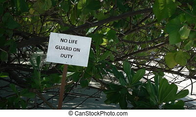 No Lifeguard on Duty Sign at Tropical beach Resort - No life...