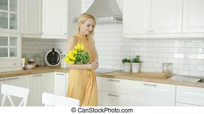 Tender female holding bouquet - Young beautiful woman...