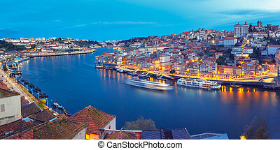 Night Old town and Douro river in Porto, Portugal. -...