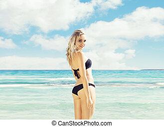 Beautiful, attractive woman in black bikini. Young and...
