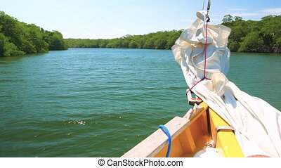 Sail Boat on a River - Boat getting from dock to the open...