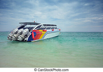 Speed boat anchored in the sea.