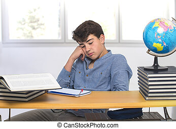 Student sitting at the desk bored in the classroom
