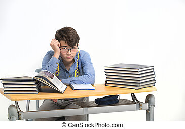 Student sitting at his desk distracted