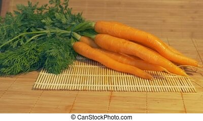 Fresh Carrots on the Table - Sliding to fresh carrots in the...