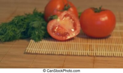 Fresh Tomatoes on Table - Sliding to fresh tomatoes in the...