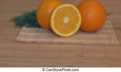 Fresh Oranges on Table - Sliding to fresh oranges in the...
