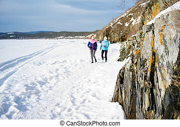 Girls keeping fit - Two girls try to keep fit by running...
