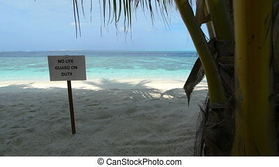 No Lifeguard Sign on a Tropical Beach Paradise. 1080p video...