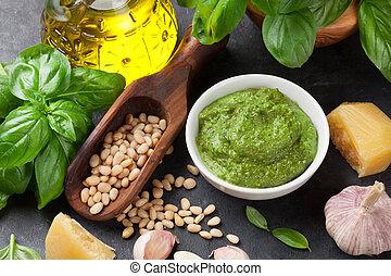 Pesto sauce cooking. Basil, olive oil, parmesan, garlic,...