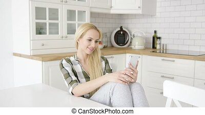 Charming female taking selfie in kitchen - Wonderful young...
