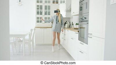 Young woman experiencing VR glasses - Young girl in grey...