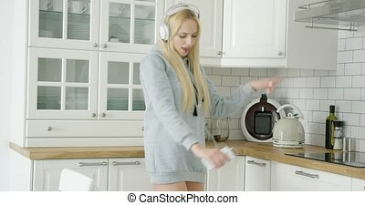 female dancer at home - Beautiful and happy woman in sweat...