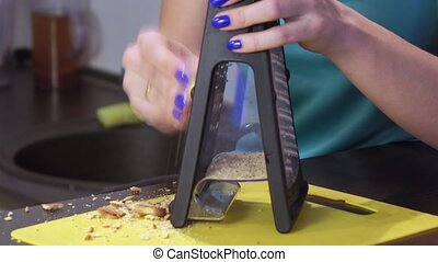 Chopping cookies with grater - The girl grinds into small...