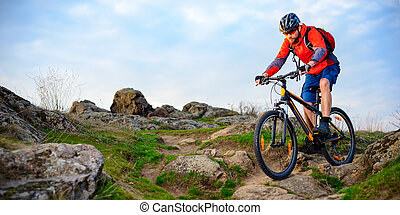 Cyclist Riding Mountain Bike on the Beautiful Spring Rocky...