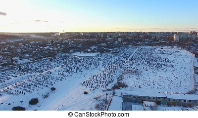 aerial view over the cemetery at winter evening