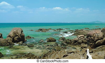 Rocky shore of a tropical sea. Phuket, Thailand. 1080p...