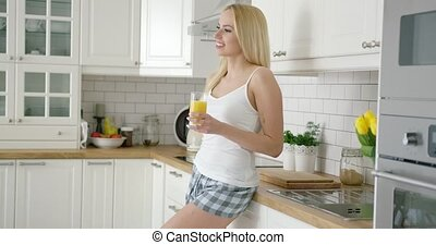 Smiling woman with glass of juice - Beautiful young girl...