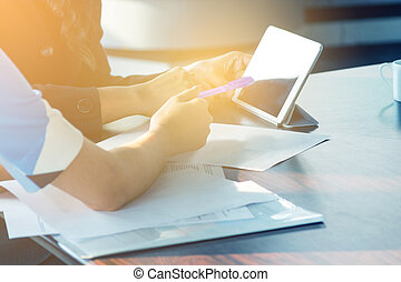 Hand of Businesswomen working on Wooden Desk with paper and...