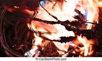 Firing wire in fire - wires on fire. Firing winding...