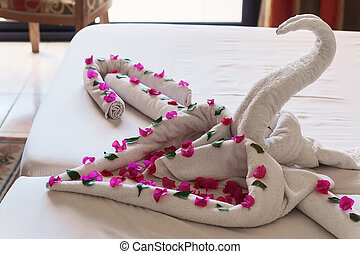 of white towels twisted swans and heartsl.
