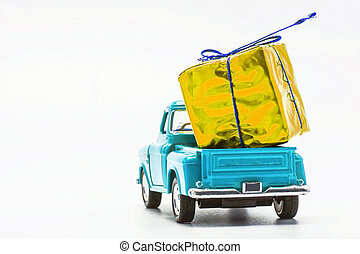 Blue retro car pickup with yellow gift box isolated