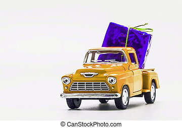 yellow retro car pickup violet gift box isolated
