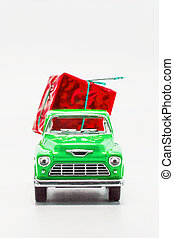 green retro car pickup with a red gift box isolated