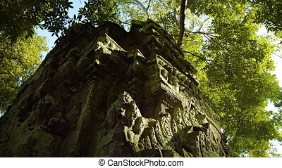Ruins of an ancient temple in the jungle. Cambodia, Angkor -...