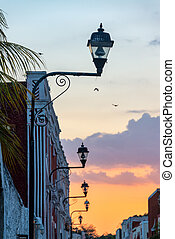 Sunset in Valladolid, Mexico - View of street lights and a...